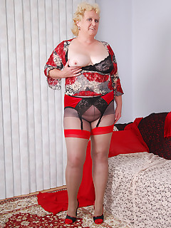 My red seam and tops stockings look so sexy with my red velvet skirt To be different I wear them on top of sheer grey pantyhose A perfect occasion to wear my..