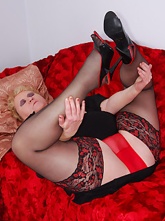 I sure like my sheer red nylon panties dont you  They look so nice on top of my black girdle  A perfect opportunity for wearing my red and black heels a new..