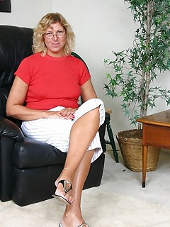Cock greedy grandma Alicia pleasures a big cock by cramming it down her willing throat